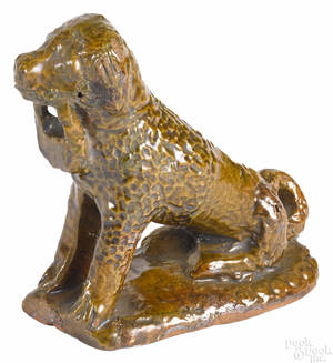 Pennsylvania redware figure of a seated spaniel 19th c