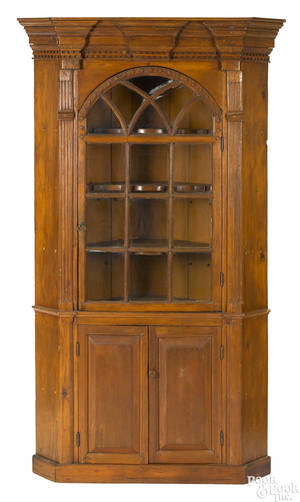 Diminutive Pennsylvania pine onepiece architectural corner cupboard ca 1790