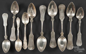 Coin and silver spoons