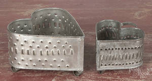 Two punched tin heart cheese molds
