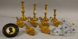 Four Brass Candlesticks a Set of Eight Opalescent Pressed Glass Curtain Tiebacks a Set of Six Empire Gilt Pressed Brass Strawberry