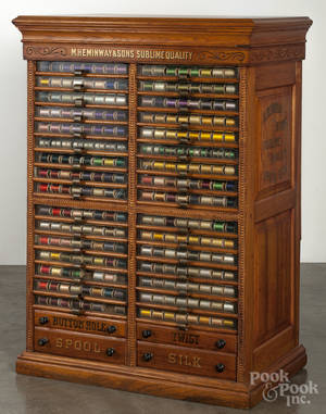 M Hemingway  Sons floor standing oak spool cabinet fitted with a large assortment of early thread