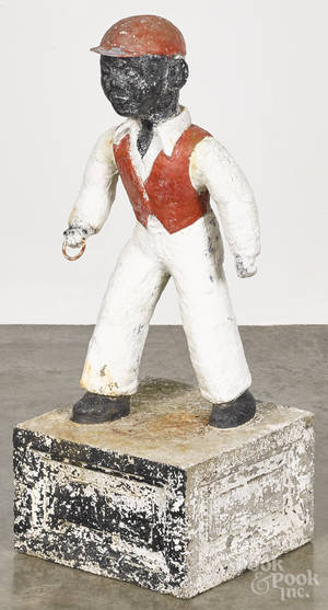 Lead jockey lawn ornament with a cement base