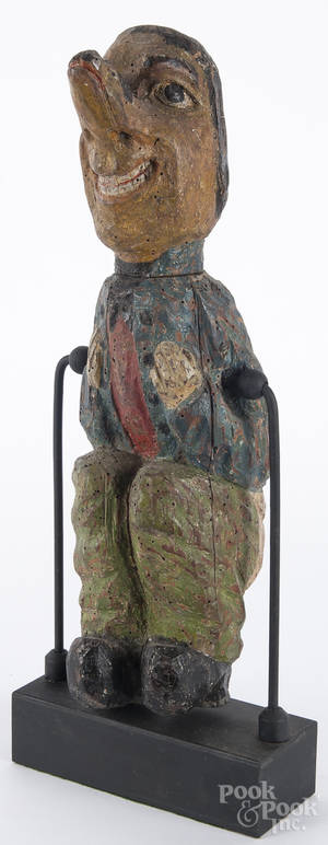 Carved and polychrome painted figure of a man