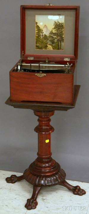 Swiss Mahogany Cased Mechanical 9 14in Disc Music Player with a Carved Mahogany Stand