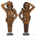 Pair of French carved walnut figureheads of a man and woman 19th c