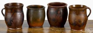 Four Pennsylvania redware crocks 19th c