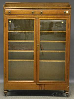 Early 20th Century Carved Oak Twodoor Book Cabinet