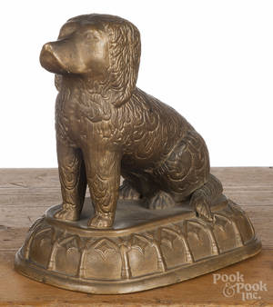 Earthenware Rockingham style figure of a seated spaniel