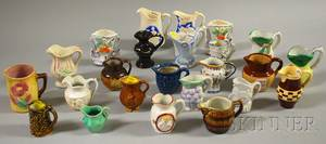 Approximately Twentyfour Assorted Miniature Ceramic Cream Jugs and Vases