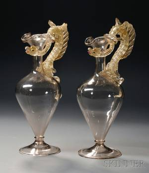 Pair of Venetian Colorless Blown and Gold Fleck Art Glass Ewers with Dragonform Handles