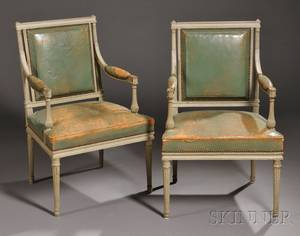 Pair of Louis XVIstyle Painted and Leatherupholstered Fauteuils