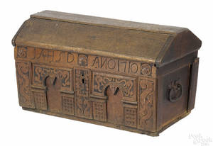 Continental carved oak casket dated
