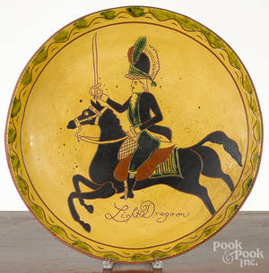 Massive Breininger redware charger decorated with a dragoon