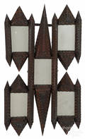 Tramp art carved mirror