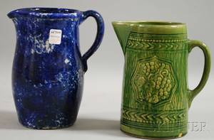 Blue and White Spongeware Pitcher and a Green Majolica Glazed Molded Stoneware Pitcher