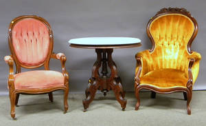 Two Victorian Rococo Revival Upholstered Carved Walnut Parlor Armchairs and a Victorian Oval White Marbletop Walnut Occasional Tabl