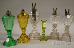 Five Assorted Glass Fluid Lamps and a Candlestick