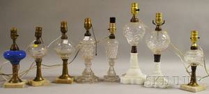 Eight Mostly Colorless Molded Glass Fluid and Kerosene Oil Table Lamps