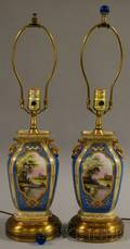 Pair of Gilt and Handpainted Landscapedecorated Porcelain VaseTable Lamps