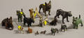 Fifteen Small Assorted Bronze and Metal Figural Dogs
