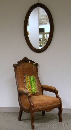 Victorian Renaissance Revival Upholstered Carved Walnut Armchair and an Oval Walnut Mirror