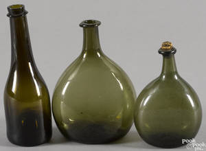 Two olive green blown glass bottles early 19th c