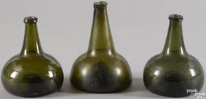 Three blown olive glass squat bottles late 18th c