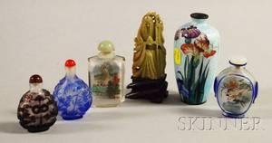 Four Chinese Glass Snuff Bottles a Carved Soapstone Figure and a Small Cloisonne Vase