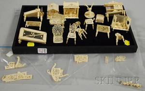 Seventeen Pieces of Miniature Carved Ivory Europeanstyle Furniture
