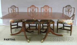 Georgianstyle Mahogany Doublepedestal Dining Table and a Set of Twelve Upholstered Carved Mahogany Dining Chairs