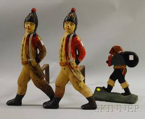 Pair of Painted Cast Iron Hessian Soldier Figural Andirons and a Painted Cast Iron Pirate Figural Doorstop