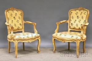 Pair of Louis XVstyle Cremepainted Carved Beechwood and Needlepoint Upholstered Fauteuil
