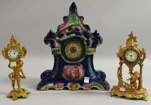 English Glazed Ceramic Cased Mantel Clock and Two Giltmetal Cherub Figural Table Clocks