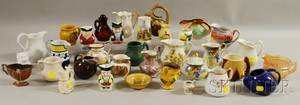 Collection of Mostly Ceramic Creamers Twelve Pieces of Milk Glass Tableware and Eight Pottery Table Items