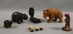 Five Carved Wood Bear Figurals and a Set of Four Small Carved Ivory Bear Bust Mounts