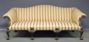 George IIIstyle Upholstered Camelback Carved Mahogany Sofa with Ballandclaw Feet