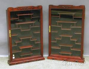 Pair of Modern Asian Carved Hardwood and Glass Display Cabinets