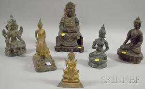 Six Patinated and Gilt Cast Bronze Seated Buddha Figures