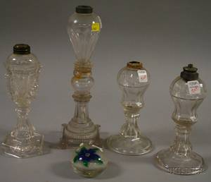 Four Colorless Glass Fluid Lamps and a Blue Flower Paperweight