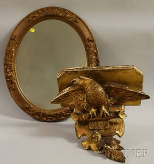 Carved Giltwood American Eagle Bracket Wall Shelf and a Rococo Revival Giltgesso Oval Mirror