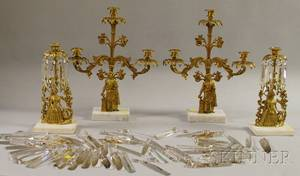 Pair of Brass Oriental Figural Garniture Candelabras and a Pair of Brass Figural Garniture Candlesticks