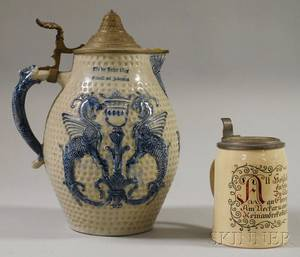 German Pewterlidded Cobalthighlighted Molded Stoneware Pitcher and a Heidelberg 12 Liter Stein