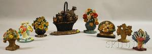 Eight Cast Iron Basket of Flowers and Fruit Doorstops