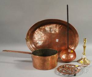 Four Pieces of Copper Kitchenware and a French Brass Candlestick