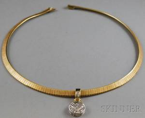 Two Gold Jewelry Items