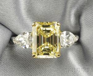 Platinum and Fancy Intense Yellow Diamond Solitaire