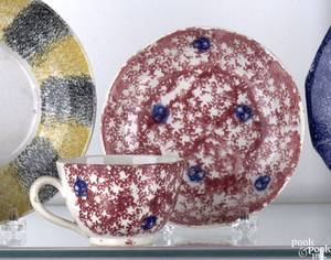 Red sponge spatter handled cup and saucer