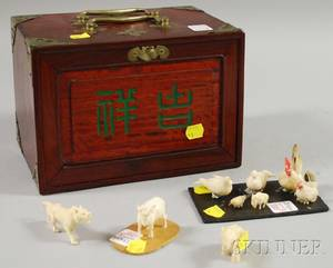 Nine Asian Miniature Carved Ivory Animal Figures and a Cased Mahjong Set