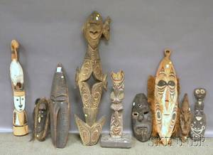 Nine Papua New Guinea Carved Wood Masks and Sculptures